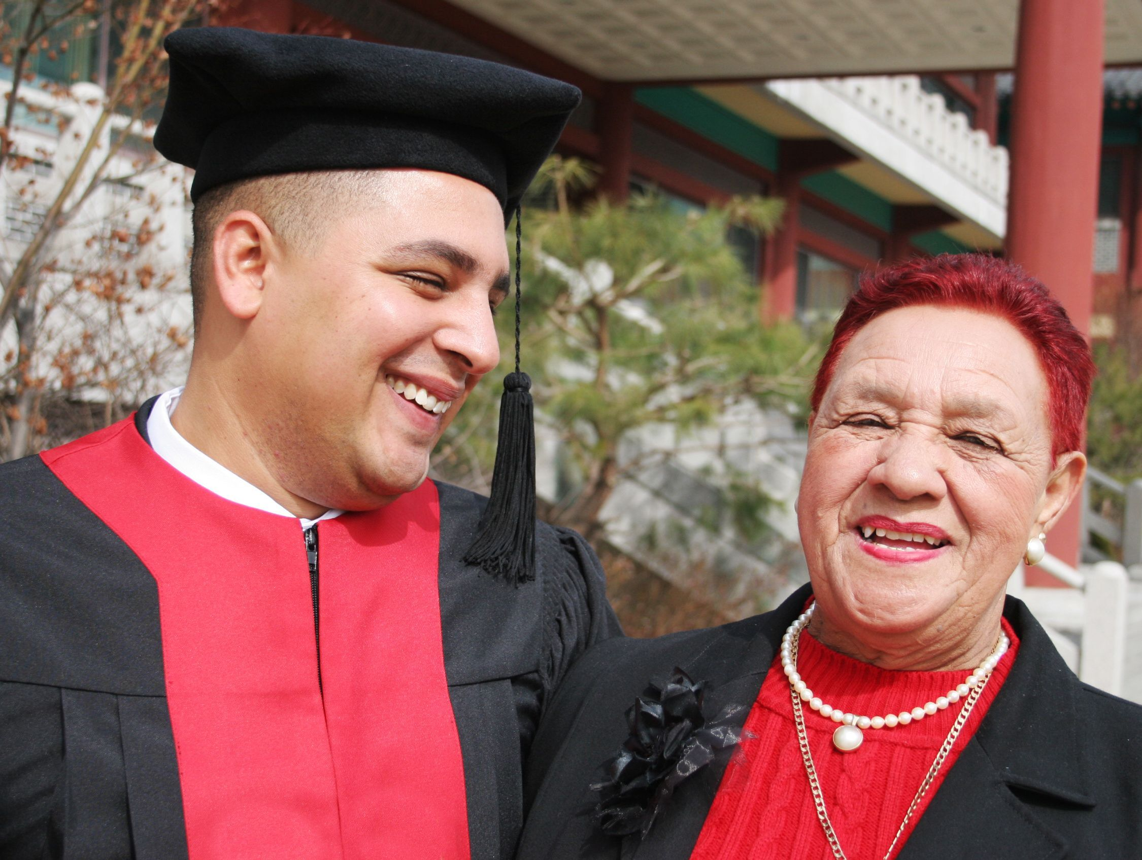University graduate shares a moment with his grandmother - happy and successful